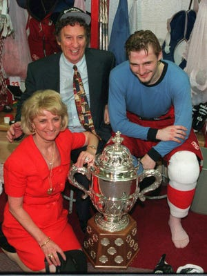 Mike and Marian Ilitch pose with Sergei Fedorov after the Red Wings won the Western Conference trophy on June 11, 1995.