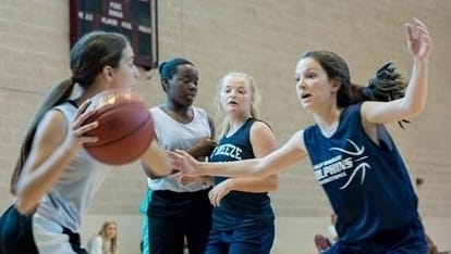 Gulf Breeze High School and Pensacola Catholic High School girls play at the 2016 Ballin' 4 Backpacks. This year's fundraising event will be held June 16-17.