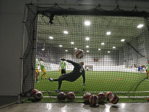 Rochester Lancers new goalie Mark Sotile guards the net during the team's practice Wednesday, Jan. 22, 2014 in Gates.