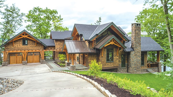 The home is made elegant by the mix of timber framing and finer exterior materials like cedar shake.