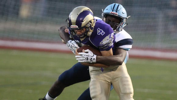 Clarkstown North's Eric Maurer carries the ball during