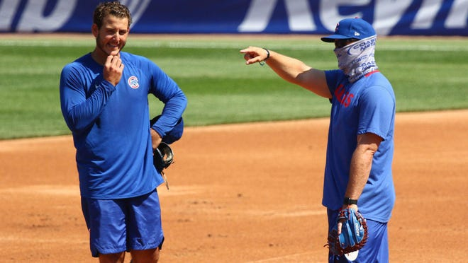 Anthony Rizzo talks with manager David Ross during a workout at Wrigley Field on July 4, 2020.
