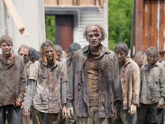Zombie walkers, who invaded Alexandria in AMC's 'The