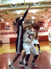 Riverheads' Forrest Shuey, right, pump-fakes Carver