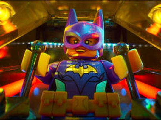"""This image released by Warner Bros. Pictures shows Batgirl, voiced by Rosario Dawson, in a scene from """"The LEGO Batman Movie."""""""