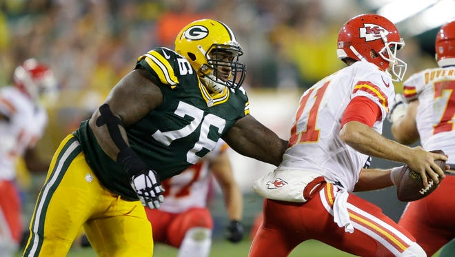 Packers defensive end Mike Daniels pressures Chiefs quarterback Alex Smith in Sept. 28's game at Lambeau Field.