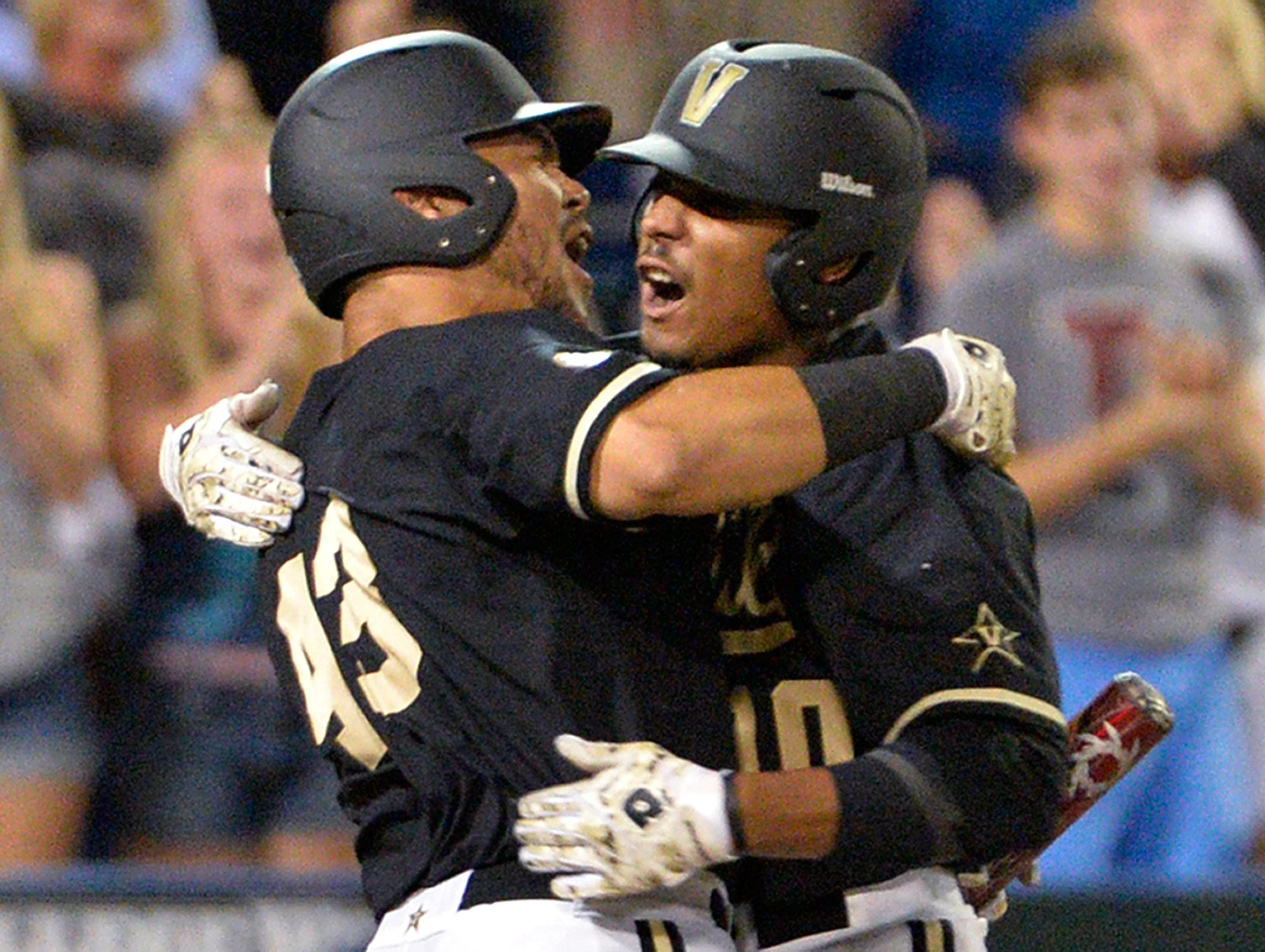 Vanderbilt's John Norwood, right, celebrates with Zander Wiel after hitting a home run against Virginia on Wednesday in Omaha, Neb. AP Vanderbilt's John Norwood, right, celebrates with Zander Wiel after hitting a home run against Virginia in the eighth inning of Game 3 of the best-of-three NCAA baseball College World Series finals in Omaha, Neb., Wednesday, June 25, 2014. (AP Photo/Ted Kirk)