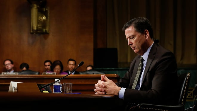 In this Wednesday, May 3, 2017, photo then-FBI Director James Comey pauses as he testifies on Capitol Hill in Washington, before a Senate Judiciary Committee hearing. President Donald Trump abruptly fired Comey on May 9, ousting the nation's top law enforcement official in the midst of an investigation into whether Trump's campaign had ties to Russia's election meddling.(