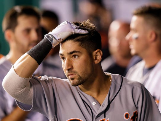 Tigers' Nick Castellanos reacts in the dugout after