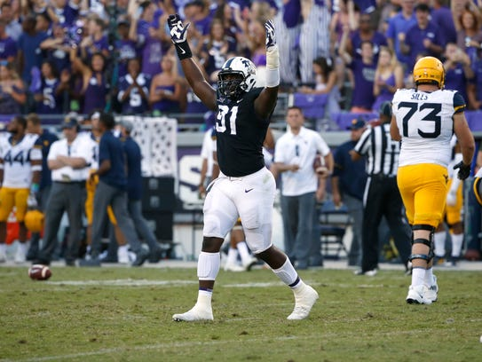 TCU defensive tackle L.J. Collier (91) celebrates as