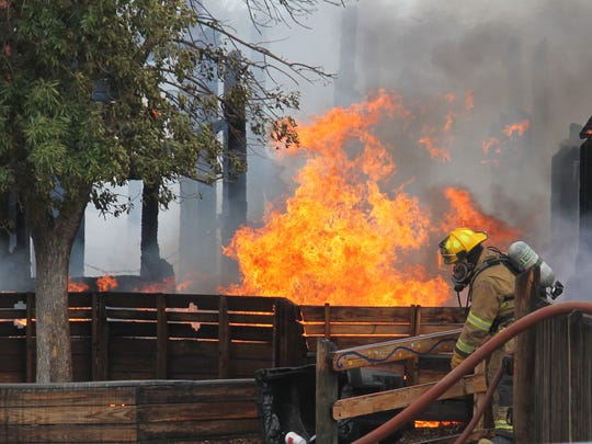 A firefighter from the Alamogordo Fire Department battles the flames Friday morning.