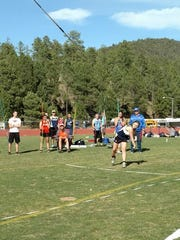 Logan Bice hurls a javelin during a meet.