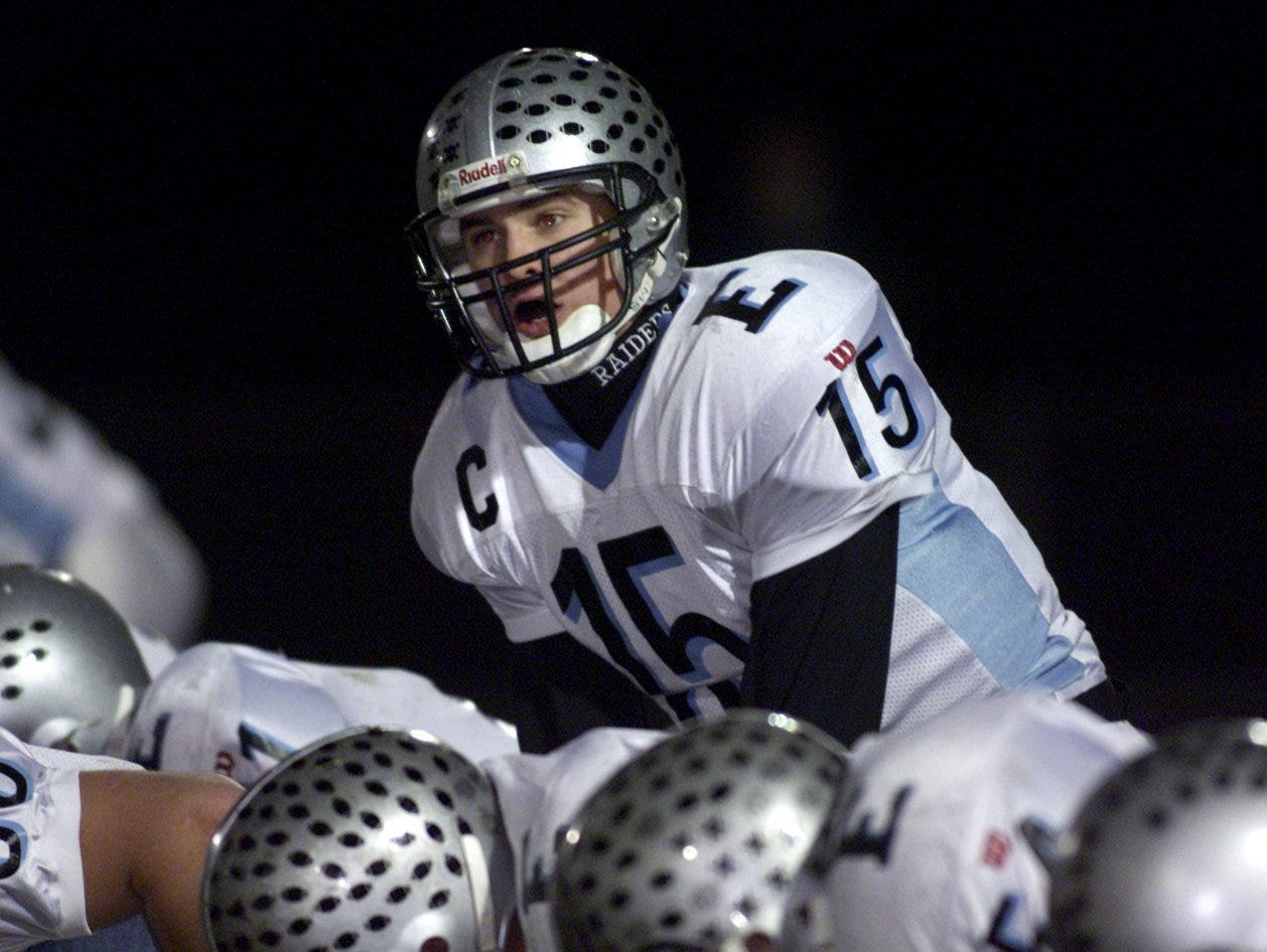 Toms River North. East' quarterback Colin Gaynor calls signals during a game in 2000.