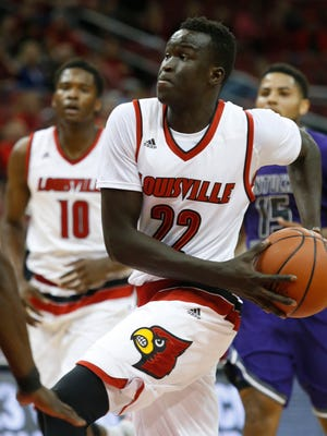 Louisville's Deng Adel drove to the lane in first half action agaisnt Kentucky Weleyan. Nov. 9, 2015.
