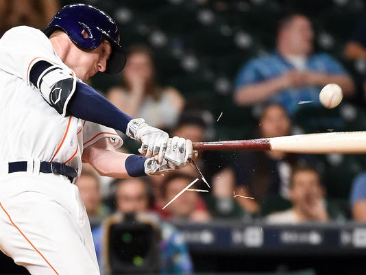 Houston Astros' Colin Moran breaks his bat while hitting a foul ball during the 12th inning of a baseball game against the Baltimore Orioles, Tuesday, May 24, 2016, in Houston. (AP Photo/Eric Christian Smith)