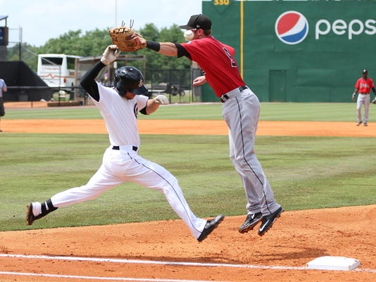 1 Jackson Generals' Tyler Smith is safe on the overthrow and makes it to second