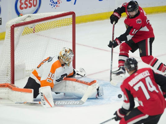 Ottawa Senators left wing Tom Pyatt (10) waits for the pass from teammate defenseman Mark Borowiecki in front of Philadelphia Flyers goalie Michal Neuvirth during the first period of an NHL hockey game, Thursday, Oct. 26, 2017 in Ottawa, Ontario. (Adrian Wyld/The Canadian Press via AP)