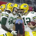 Green Bay Packers wide receiver Jeff Janis (83) celebrates his touchdown reception with quarterback Aaron Rodgers (12) against the Arizona Cardinals at University of Phoenix Stadium.