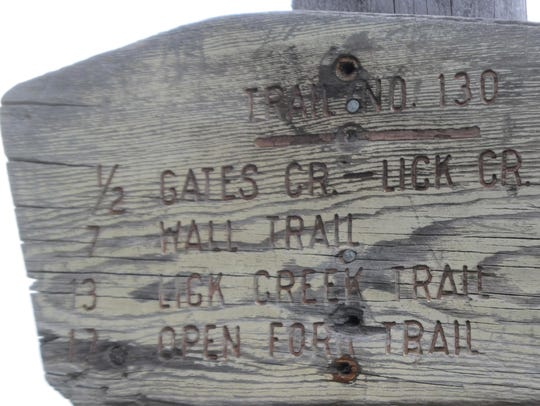 Trail signs in the Bob Marshall wilderness show the