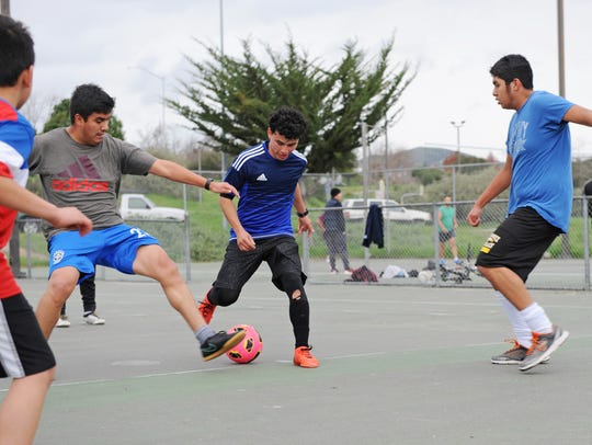 Friends from La Luz del Mundo Church in east Salinas play in a pickup game at Natividad Creek Park in Salinas. The city is gathering opinions to shape its Master Parks Plan, which will guide park and library development decisions throughout Salinas over the next several years.