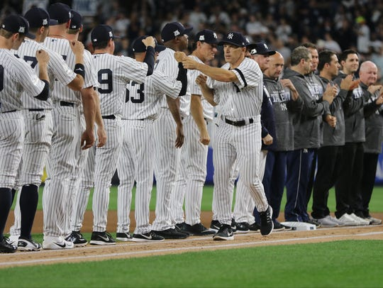 Joe Girardi was booed when he was introduced, Sunday,