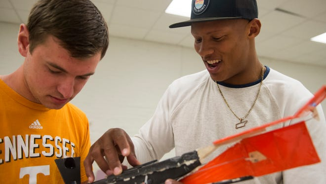 Aerospace engineering students Travis Roock and former University of Tennessee quarterback Josh Dobbs work on  attaching a piece to a plane they are building for their senior project in Estabrook Hall on UT's campus Tuesday, April 18, 2017.