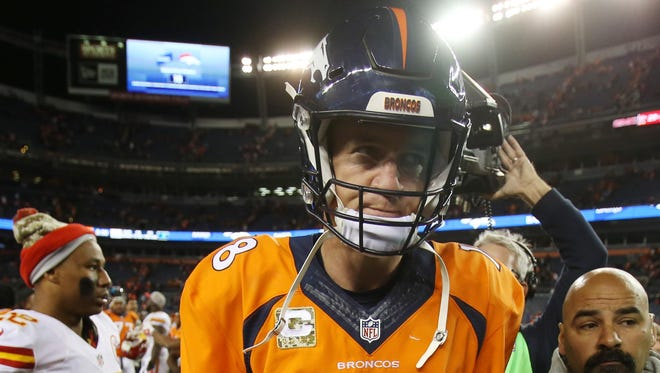 Denver Broncos quarterback Peyton Manning (18) leaves the field after the game against the Kansas City Chiefs at Sports Authority Field at Mile High.