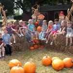Pre-K students with The Playhouse in Farmerville pose for a photograph at the First United Methodist Church's Pumpkin Patch in Monroe on Thursday.