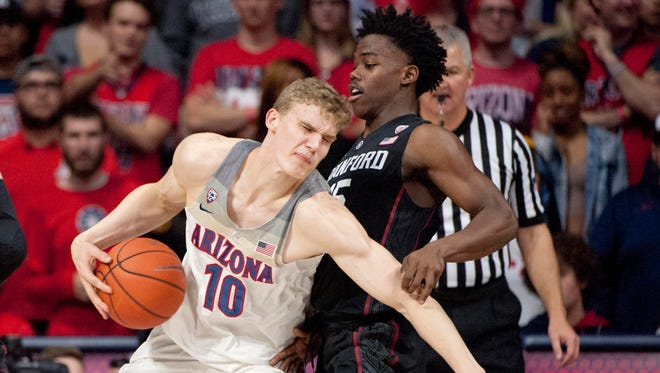 Feb 8, 2017: Arizona Wildcats forward Lauri Markkanen (10) makes a move defended by Stanford Cardinal guard Marcus Allen (15) during the first half at McKale Center.