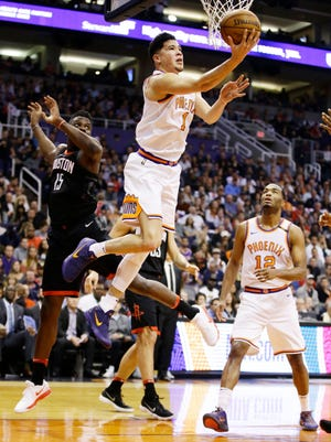 Suns guard Devin Booker ranks eighth in the NBA at 3.6 turnovers per game, up from 3.1 last season. Coach Jay Triano says it's natural for a player who often is the team's primary ballhandler to have a high turnover rate.