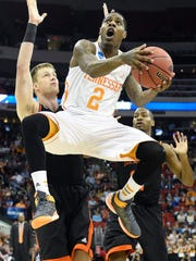 Tennessee guard Antonio Barton (2) attempts a layup past Mercer defense during the first half of a third-round NCAA tournament game at the PNC Arena in Raleigh, N.C. on Sunday, March 23, 2014.