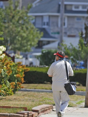 A US Census worker walks door to door on Samoset Ave. Hull on Tuesday August 18, 2020 Greg Derr/The Patriot Ledger