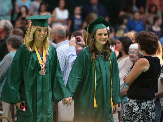 Graduates make their entrance during the Regis High School commencement on Sunday, June 5, 2016, in Stayton.