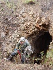 Jason Corbett, BCI Subterranean Program Director ascends from a cave.