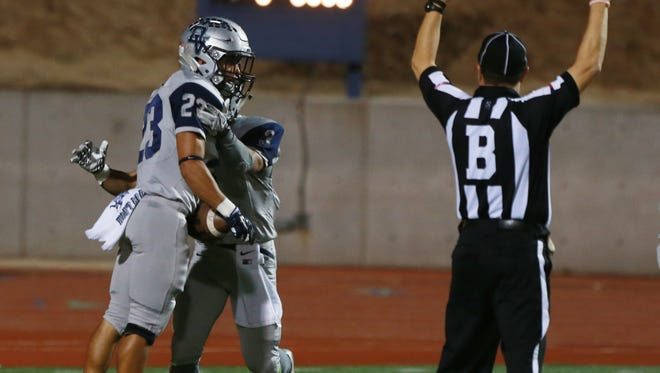 Del Valle running back Jason Morales, left, celebrates a touchdown with a teammate.