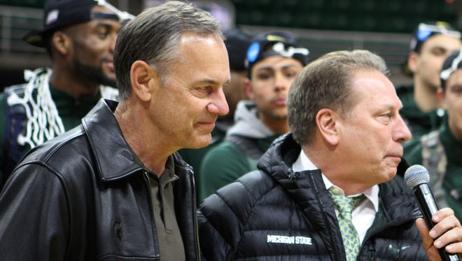 Michigan State basketball coach Tom Izzo speaks next to football coach Mark Dantonio on March 29, 2015, in East Lansing.