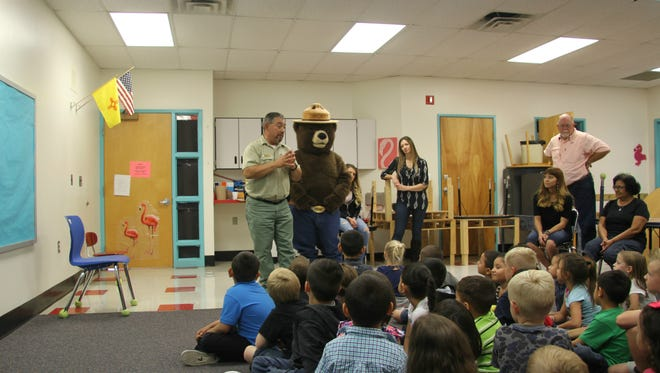 Students at Early Childhood Education Center learned about wildfires and met Smokey Bear Wednesday.