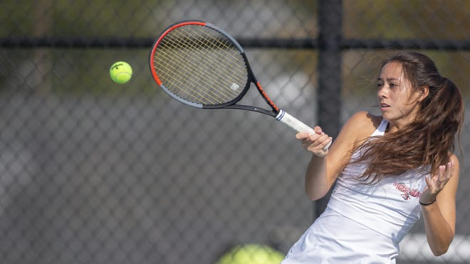 Auburn's four-time NIC-10 tennis champ Belen Nevenhoven hits a forehand during her 6-0, 6-0 win Saturday in the No. 1 singles finals of the conference girls tennis tournament at Harlem in Machesney Park.