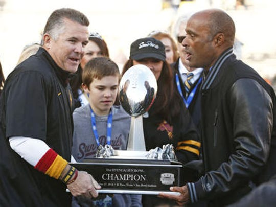 Ray Anderson, right, is one year into his job as ASU