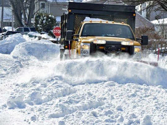 Guy Shaul, borough recreation department, runs a snowplow over a section of Third Street, Chambersburg on Jan. 25 after winter storm Jonas.
