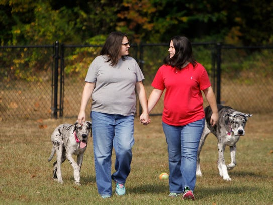 Dana, left, and Kristy Dumont of Dimondale walk with
