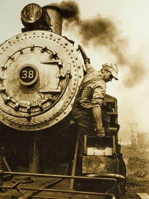 """""""The Engineer"""" — Kevin McGarvey, engineer, Livonia, Avon & Lakeville Railroad 1974. The object in his right hand is the stack fan used to draw air over the coals, creating a draft and heating the boiler quicker to bring up steam faster."""