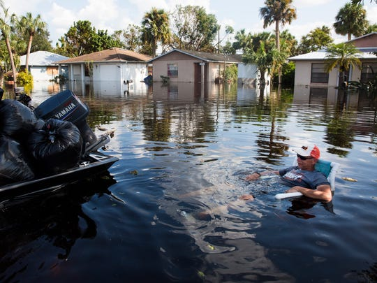 Don Manley sits for a quick break after helping residents load their belongings onto his boat along the flooded Quinn Street area in Bonita Springs on Friday, Sept. 15, 2017, five days after Hurricane Irma. Manley has been ferrying residents to their flooded homes since Tuesday.