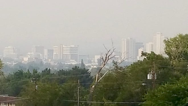 A look at the haze over downtown Reno from North McCarran Boulevard and U.S. 395, taken on Aug. 4, 2018.