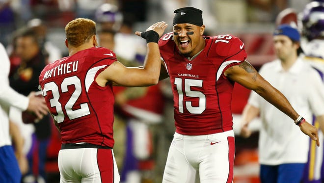 Arizona Cardinals Tyrann Mathieu and Michael Floyd (15) celebrate against the Minnesota Vikings in the first half on Dec. 10, 2015, in Glendale.