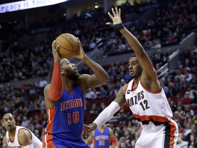 Detroit Pistons forward Greg Monroe, left, looks to