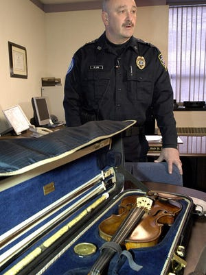 Billings, Mont., Police Chief Rich St. John holds a news conference Dec. 20, 2006, to announce the recovery of an 1879 Eugenia Praga violin valued at $50,000, which had been stolen from the Billings airport.