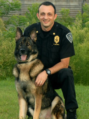 Newburgh Police Chief Eric Mitchell and K-9 officer Alex.