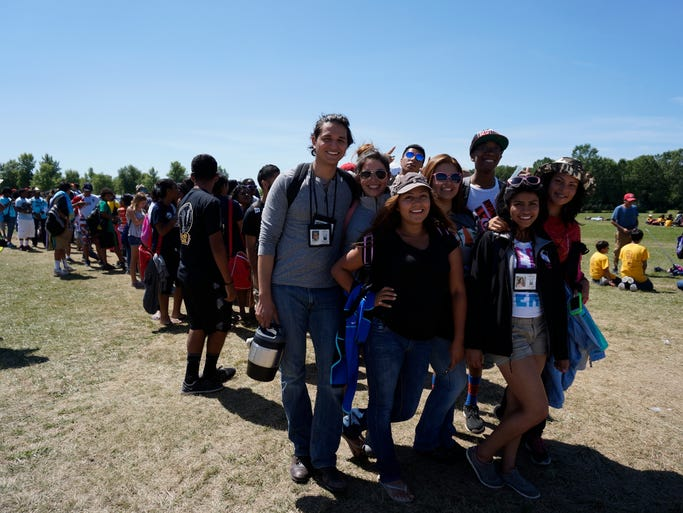Pathfinders from Virginia wait in line for a bus ride to go canoeing at the Pathfinder Camporee.