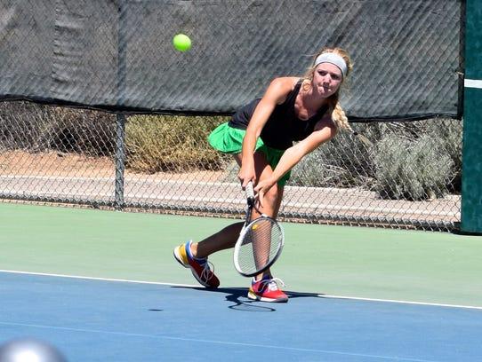 Farmington's Eliza Merrion returns a volley on the